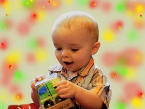Moorside Stars Nursery - baby playing with boo